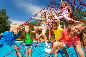 foto of playground  - Happy large group kids on red ropes playing together on playground park - JPG