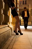 stock photo of prostitute  - Sexy woman waiting for man on the street