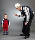 picture of discipline  - Grandfather trying to discipline his naughty grandson - JPG