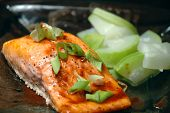 image of steelhead  - Glass plate with a steelhead salmon fillet and steamed summer squash - JPG