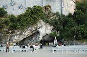 Persons Outside Landmark Of Lourdes poster
