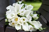 stock photo of calla  - Bridal bouquet of calla lilies and tulips flowers for the wedding ceremony - JPG