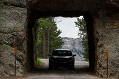 pic of mount rushmore national memorial  - traveling from mount Rushmore with a view from a distant road tunnel - JPG