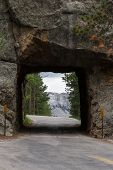 stock photo of mount rushmore national memorial  - view of mount Rushmore from a distant road tunnel - JPG
