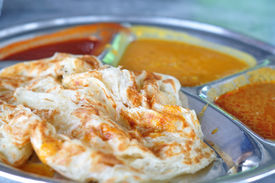 pic of malaysian food  - Roti canai flat bread Indian food made from wheat flour dough - JPG
