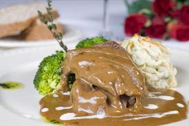 stock photo of camel-cart  - A la carte meal of camel steak in a gravy sauce - JPG