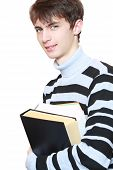 Young Guy With Books In Hands.