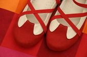 image of ruby red slippers  - Dance shoes on red cushion - JPG