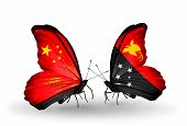 picture of papua new guinea  - Two butterflies with flags on wings as symbol of relations China and Papua New Guinea - JPG