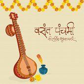 stock photo of saraswati  - Traditional musical instrument Veena with flowers decoration - JPG