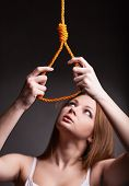 image of death penalty  - Young woman wants to hang on a dark background
