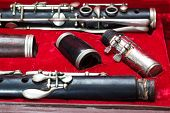 stock photo of clarinet  - clarinet wind instrument disassembled and placed in the case - JPG