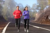 picture of country girl  - Healthy running runner man and woman workout on mountain road - JPG