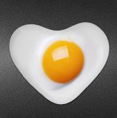 picture of human egg  - Fried egg like heart on frying pan  - JPG