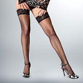 foto of fetish fishnet stockings  - Sexy long muscular female legs in high heels - JPG