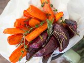 stock photo of beet  - roasted carrots and beets with thyme and rosemary - JPG