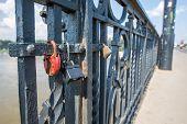 stock photo of polonia  - love padlocks on a bridge in Warsaw Poland - JPG