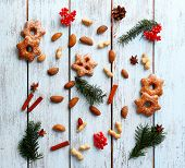 pic of hazelnut tree  - Cookies with nuts and sprigs of Christmas tree on color wooden background - JPG