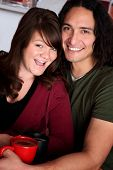 stock photo of native american ethnicity  - Caucasian and Native American couple snuggling at a cafe - JPG