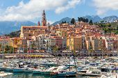 foto of old boat  - Old colorful houses overlooking small marina with yachts and boats in Menton  - JPG