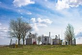 foto of substation  - Substation small gas pressure in the field of landscape - JPG