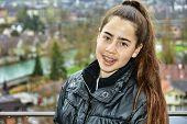 stock photo of braces  - Teenage girl with pink braces on her teeth in touring Bern Switzerland Europe - JPG