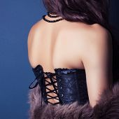 picture of corset  - woman wearing corset and fur in retro style - JPG