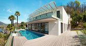 architecture, modern house, beautiful patio with pool, outdoor poster