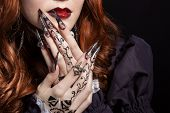 stock photo of long nails  - beautiful long sharp black graft acrylic   nails image for witches - JPG
