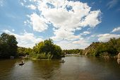 picture of water bug  - The wide river Southern Bug in Ukraine with the blue cloudy sky - JPG