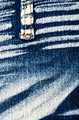 foto of denim jeans  - Worn striped denim jeans texture with strap - JPG