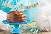 picture of cake stand  - Birthday Chocolate Cake with one candle on cake stand - JPG