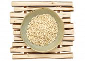 picture of ceramic bowl  - sprouted brown rice in a ceramic bowl on a wood stick trivet - JPG