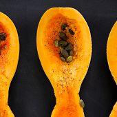 foto of butternut  - butternut squash piece with pumpkin seeds on black background topview - JPG