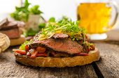 picture of cheese-steak  - Devilish fried bread with peppers chilli and beef steak topped cheddar cheese and microgreens with czech beer - JPG