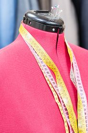 stock photo of dress mannequin  - red tailor dummy  - JPG