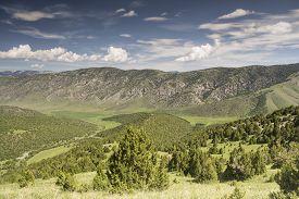 stock photo of shiva  - Mountain Valley Shiva,  Kyrgyzstan, Batken Province,  a picturesque valley where  pastoralists live - JPG