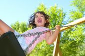 Girl Swinging Swing In Outdoor Park Nature