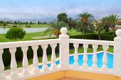 stock photo of balustrade  - Golf course view from house with pool white balustrade - JPG