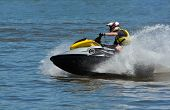 foto of jet-ski  - Man Riding Jet Ski Wet Bike Personal Watercraft - JPG