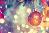 Christmas and New Year Decoration. Golden Bauble hanging on Christmas Tree. Holiday Glowing Backgrou poster