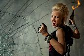 image of brass knuckles  - Punk girl behind broken glass - JPG