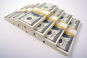 foto of ten thousand dollars  - Stacks of Ten Thousand Dollar Piles of One Hundred Dollar Bills on a White Background - JPG
