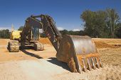 image of exhumed  - An industrial excavator at a construction site - JPG