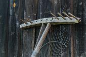 Wooden and metal rake. Object photo. horizontal shot