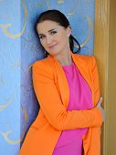 Pretty Fashion Woman In Bright Clothes Indoors. House Interior