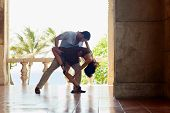 image of bolero  - young hispanic couple dancing latin american dance outdoors - JPG