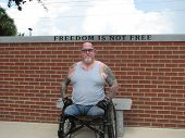 picture of amputee  - A Vietnam Vet enjoying a day in the park and sun - JPG