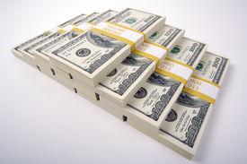 foto of one hundred dollar bill  - Stacks of Ten Thousand Dollar Piles of One Hundred Dollar Bills on a White Background - JPG