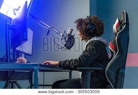 poster of Professional Girl Gamer Plays In Video Game On Her Computer. Shes Participating In Online Cyber Game
